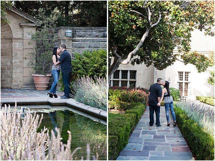 A couple holding hands and kissing in a garden