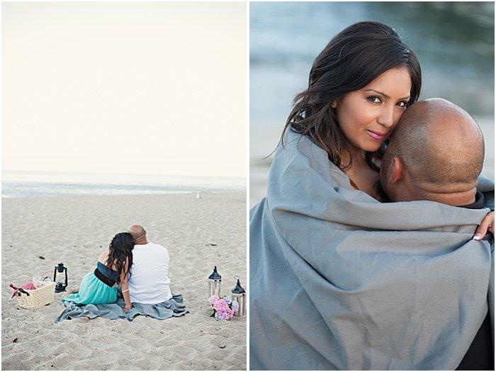 A couple cuddling on the beach