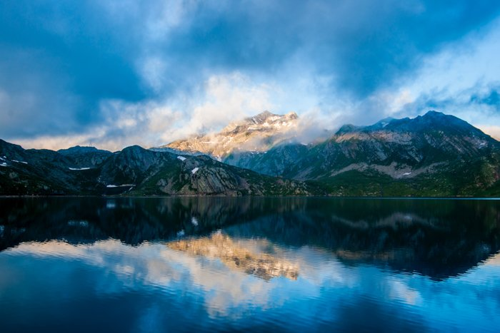 Landscape photo of a lake with mountains in the background