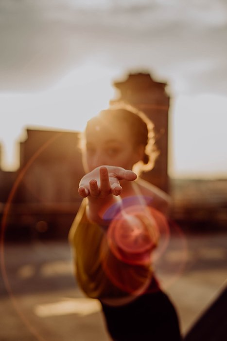 A photo of a girl holding out her hand, only the hand is in focus