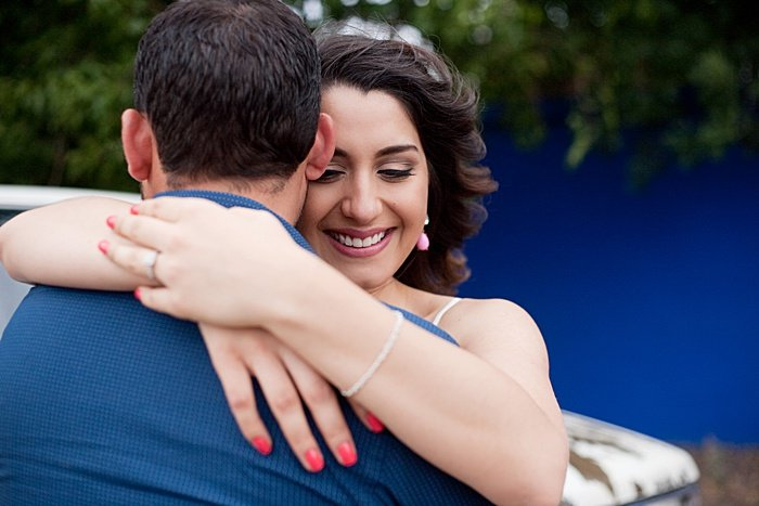 A couple embracing, shot from over the shoulder