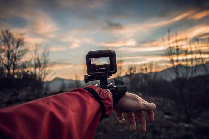A GoPro camera on a persons wrist