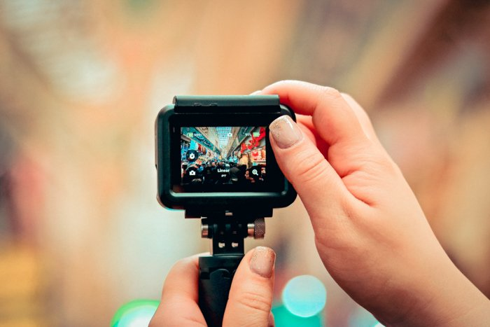 An image of hands holding a GoPro to take a picture