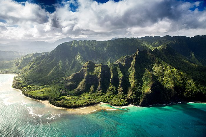 Beautiful green mountains surrounded by ocean