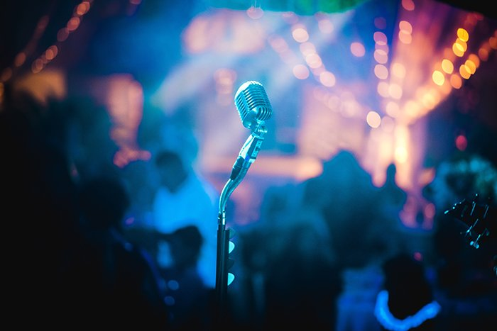 a microphone stand at a nighttime event