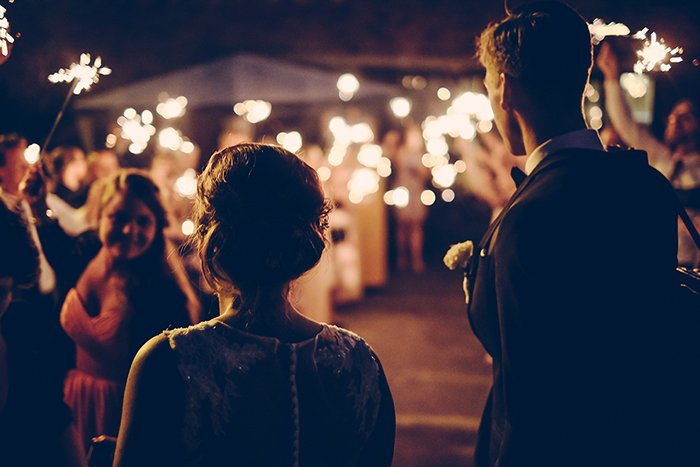 a candid photo of an outdoor wedding celebration at night