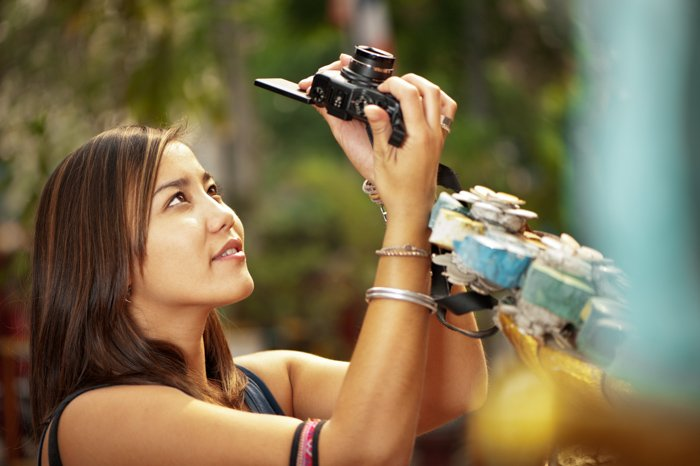 Photo of a woman taking a photograph