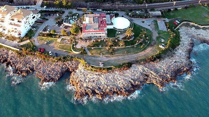 Drone photo of a building by the beach