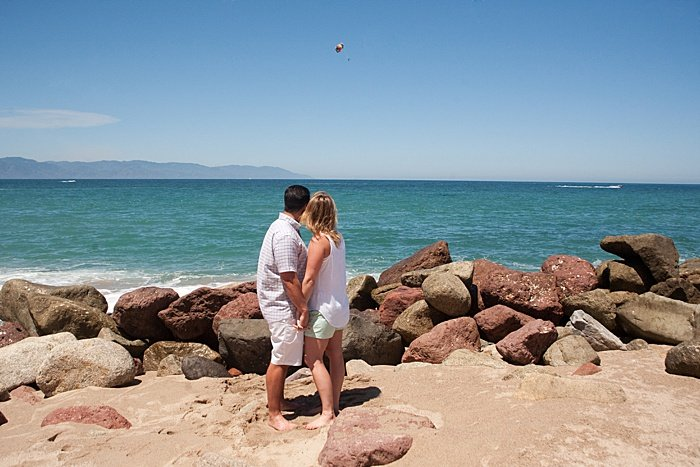Romantic portrait of a couple holding hands on the beach