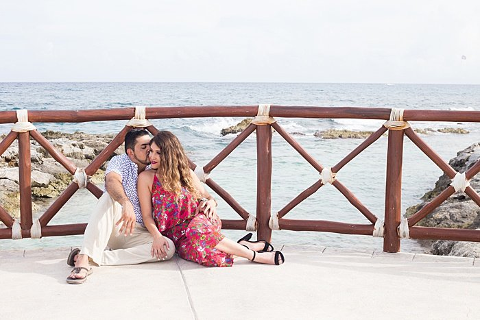 A couple on the beach, shot in the 'T-bone' engagement photo pose