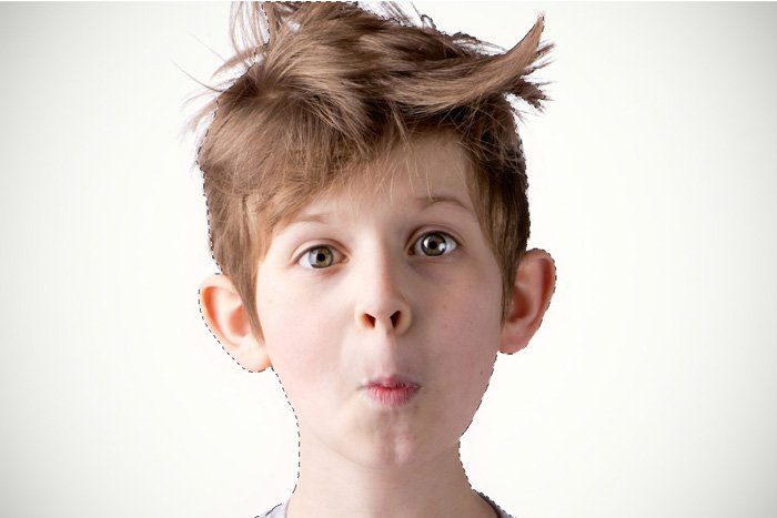 Using Photoshop to make a selection of a portrait of a little boy with messy hair