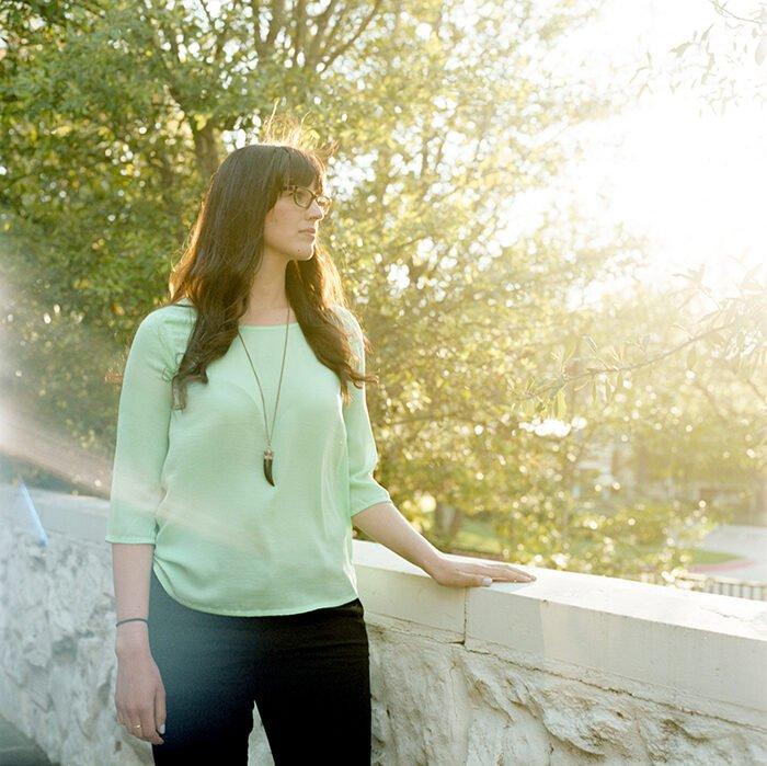 Portrait photo of a woman at a park