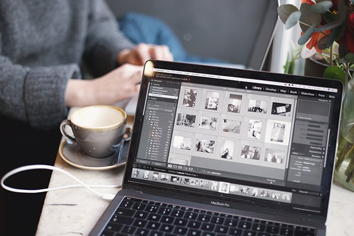 Photo of a laptop with a coffee mug next to it