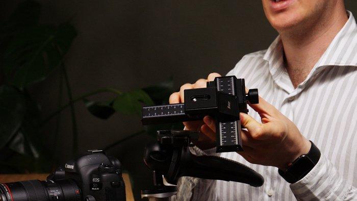 Photo of a man setting a camera
