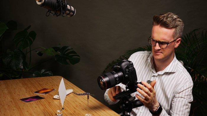 Photo of a man using a macro focusing rail