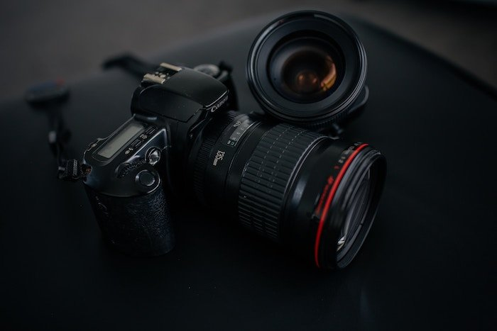 Photo of a camera and a lens