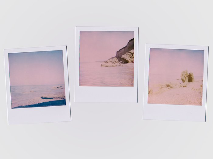 Photo of three Polaroid pictures in a pinkish hue