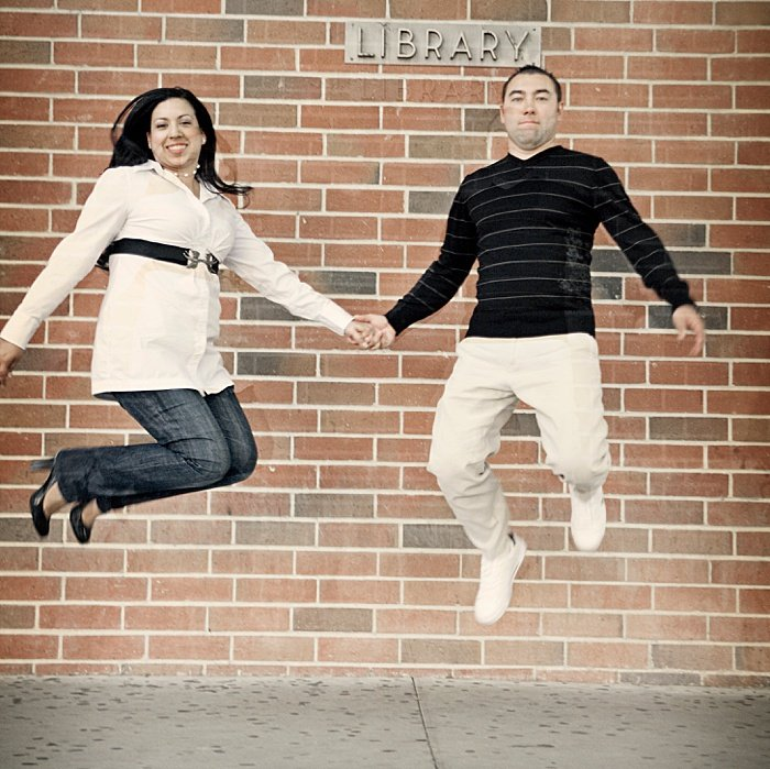 Fun engagement portrait of a couple jumping