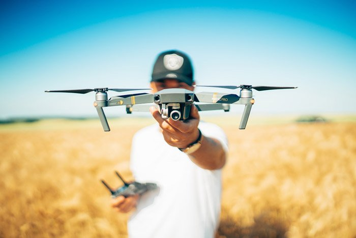 Photo of a man holding a drone