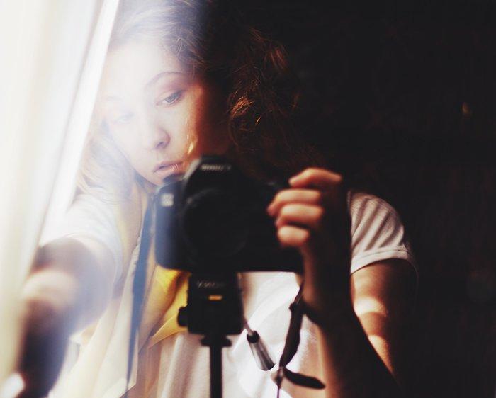 a self portrait of a female photographer