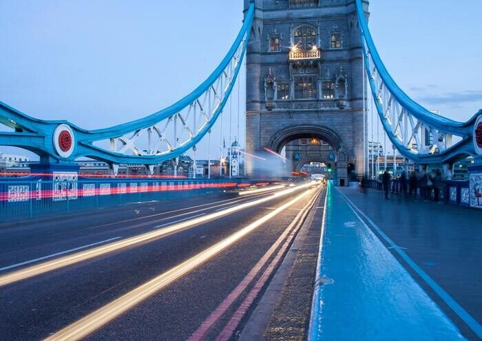 Motion blur of traffic lights on a bridge