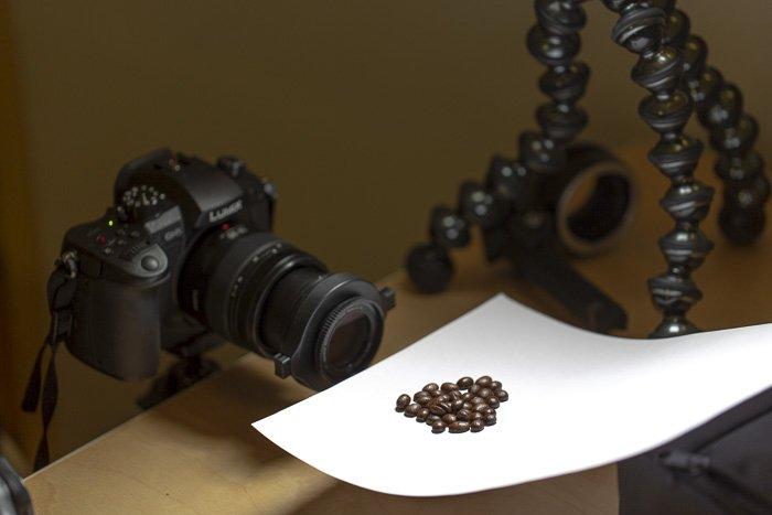 a dslr on a tripod setup to shoot macro photos of coffee beans