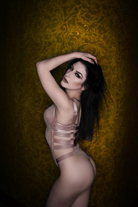 Boudoir photo of a woman in nude lingerie