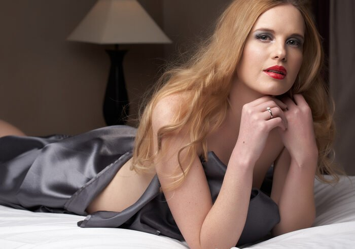 Boudoir photo of a woman lying on a bed