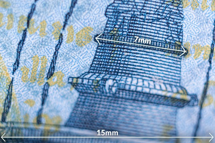 A macro shot of a tiny section of the Hungarian 1000 HUF banknote