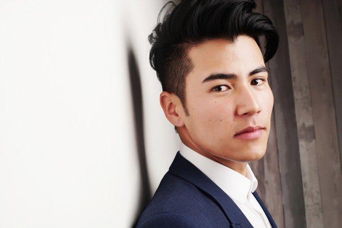 a professional headshot photo of a stylish young man