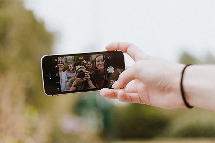 a person taking a photo with a smartphone