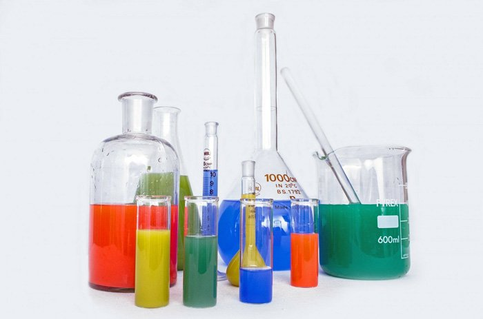 Photo of containers with different color liquids