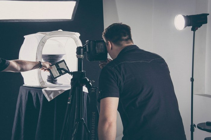 Photo of a man taking a product photo