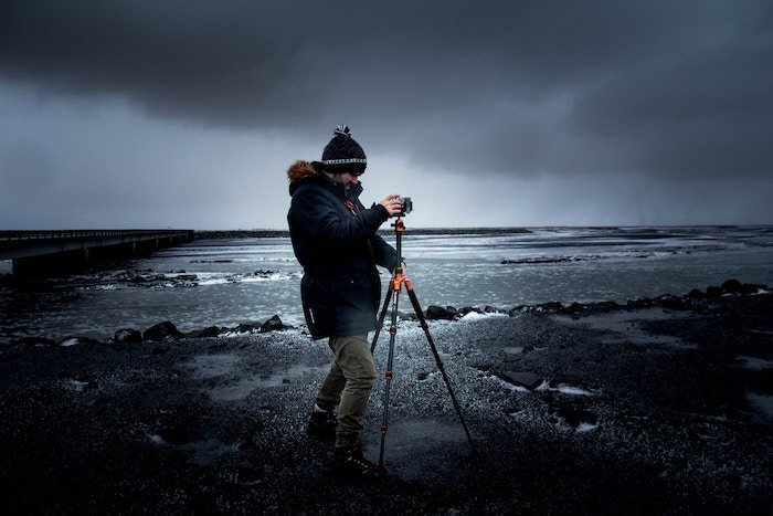Photo of a photographer with a camera on a tripod