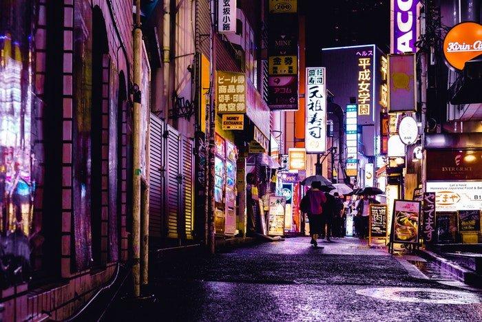 a Japanese street scene at night