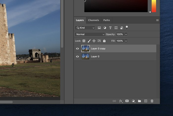 a screenshot of unlocking the background layer in Photoshop
