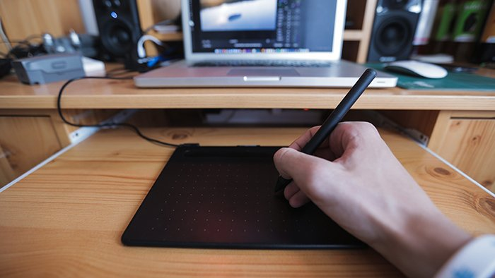 a close up of a person editing with Photoshop plugins