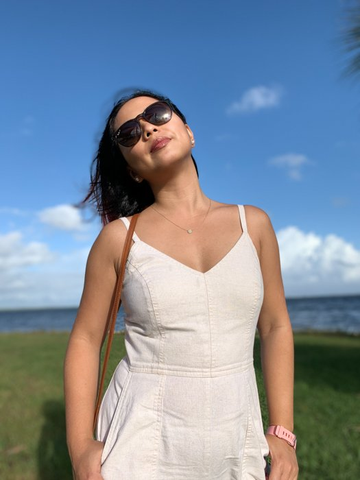 A woman wearing sunglasses basking in the light