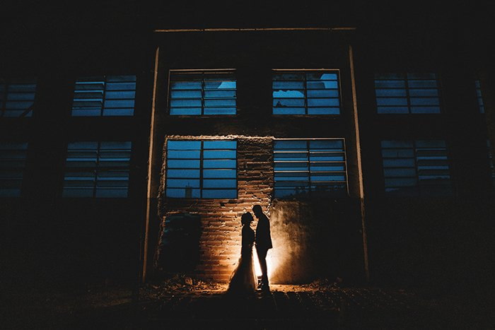 A silhouette of a bride and groom