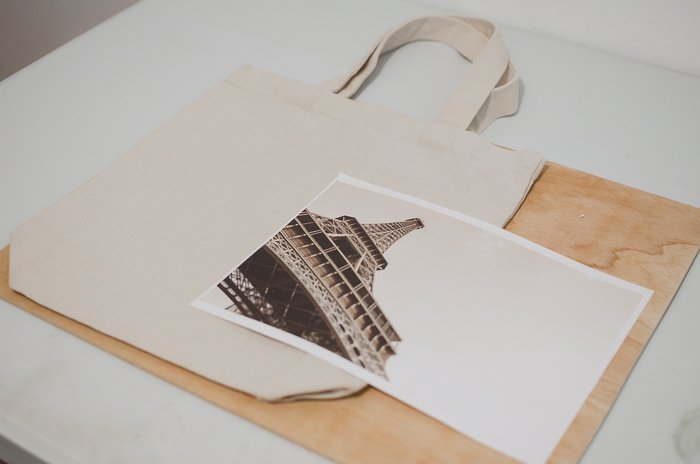 Photo of a canvas bag and a print of the Eiffel Tower