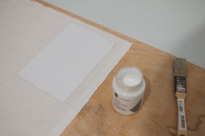 Photo of a paper a brush and a small can