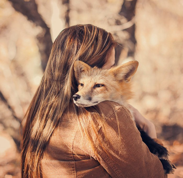 Photo of a girl holding a fox