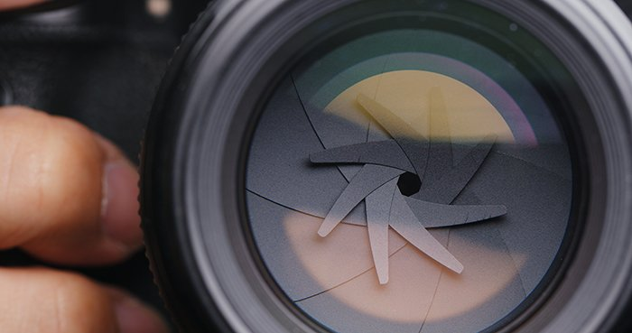 Adjusting Camera lens aperture.