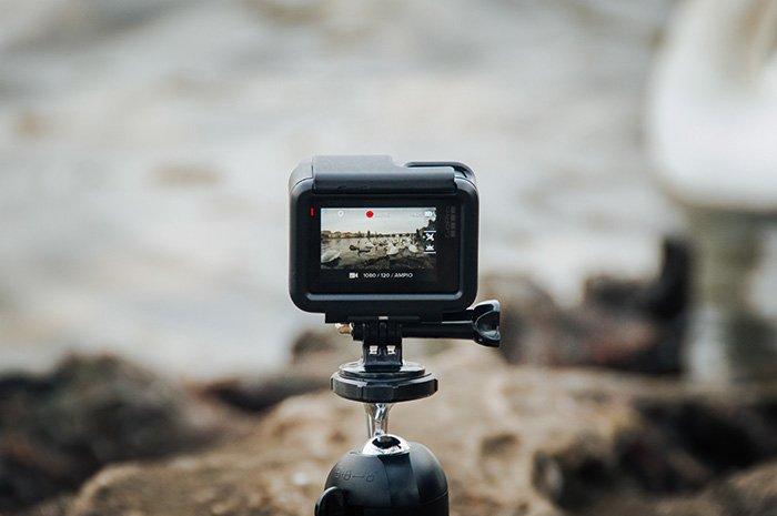 A gopro camera set up on a tripod