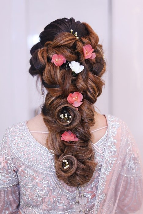 A wedding hair style with flowers and pearls