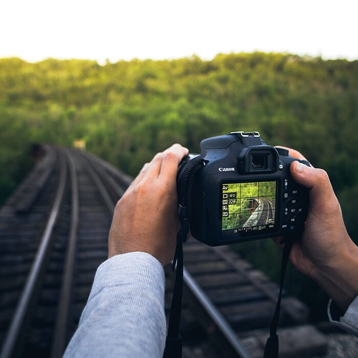 Photo of someone taking a photo on the railway