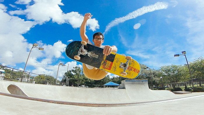 Photo of a guy doing a skateboard trick