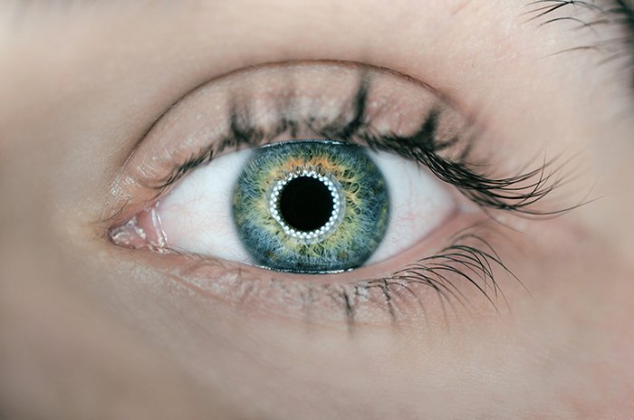 close-up photo of an eye with ring light