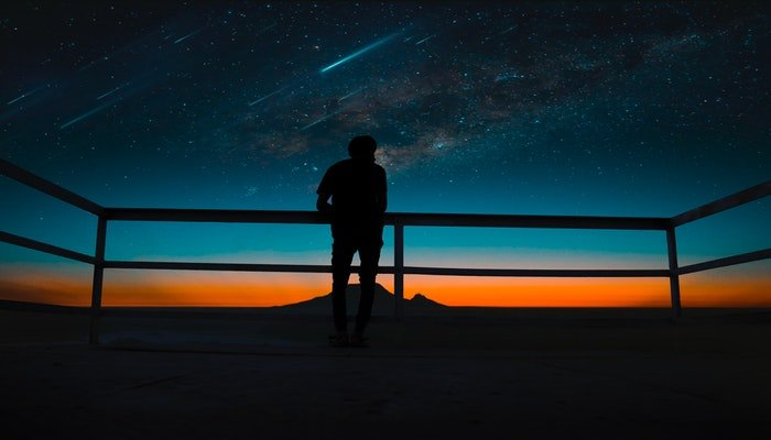 Silhouette of a person against the night sky