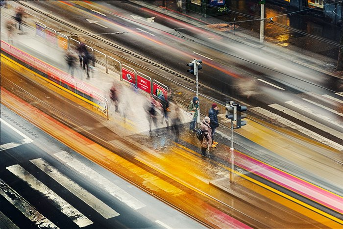 A composite of 11 images showing motion blur of trams in Budapest